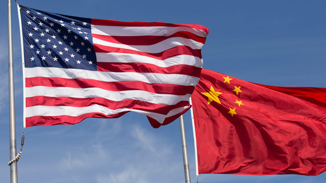 U.S. and chinese flags waving in the wind