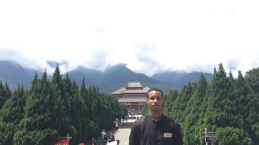 Khyle Eastin in front of Chinese landmark