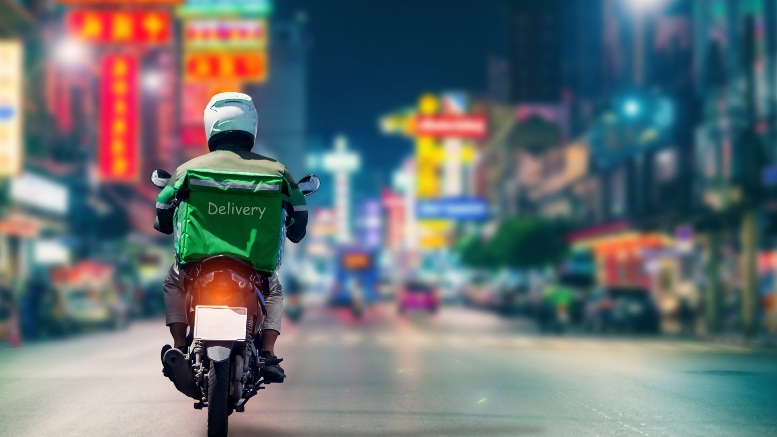 Man on Motorbike delivers products to customers who ordered online